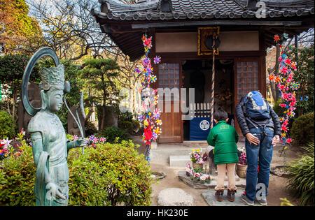 Temple area dedicated to dead unborn children, in Zojoji temple, Tokyo, Japan - Stock Photo