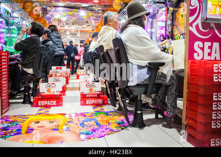 Playing Pachinko, Shibuya, Tokyo, Japan - Stock Photo