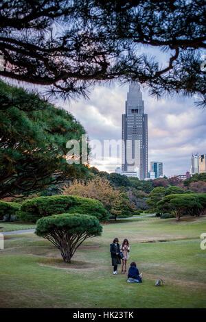 Townscape, Girl, girls, Woman, women, NTT Docomo Yoyogi building, from Shinjuku Gyoen park, Tokyo - Stock Photo