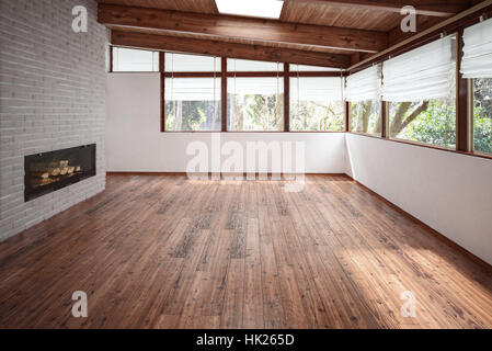 Empty room with panoramic windows, wooden floor and ceiling and modern minimalist fireplace. Architecture and interior - Stock Photo