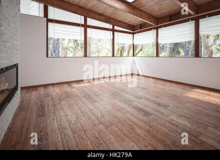 Empty living-room with fireplace, wooden floor and ceiling with beams and huge panoramic windows. 3d rendering. - Stock Photo