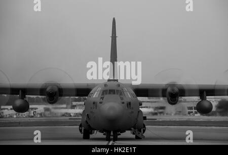 A modified C-130 Hercules assigned to the 910th Airlift Wing at Youngstown Air Reserve Station, Ohio, starts up - Stock Photo