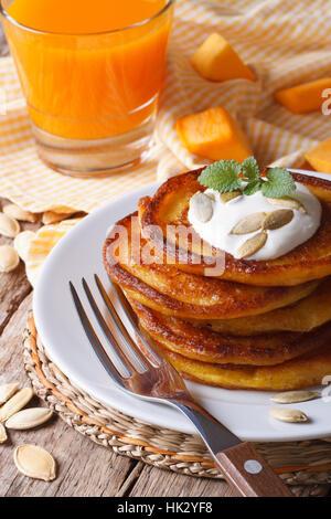 Healthy breakfast: pumpkin pancakes and juice closeup. vertical - Stock Photo