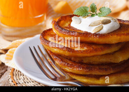 Delicious pumpkin pancakes with sour cream and juice macro. horizontal - Stock Photo