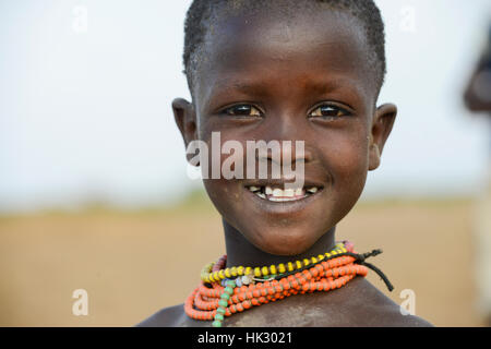 ETHIOPIA, Southern Nations, Lower Omo valley, Kangaten, village Kakuta, Nyangatom tribe, young girl with necklace - Stock Photo