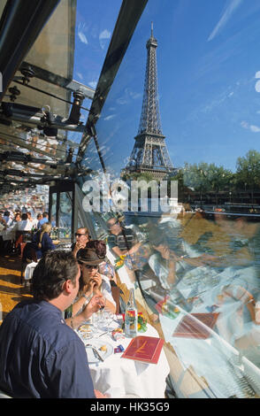 Couple enjoying view during a boat trip on the Seine River, Paris, France - Stock Photo