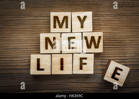 'My New Life' inscription on made from wooden blocks - Stock Photo