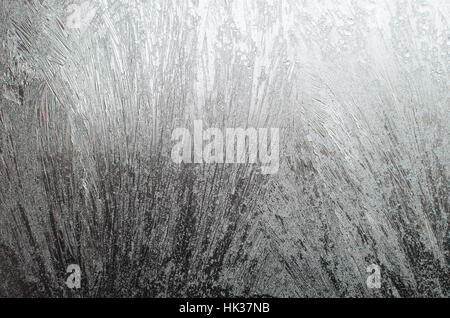 Surface of a window glass with frostwork as a background - Stock Photo