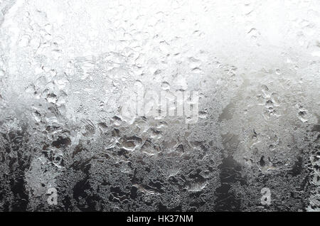 Icy window surface with frostwork as a background - Stock Photo