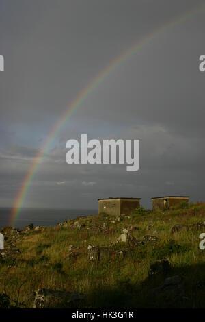 An amazing double rainbow over the military ruins at Cramond Island, Edinburgh, Scotland - Stock Photo