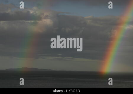 An amazing double rainbow over Inchmickery Island, Edinburgh, Scotland - Stock Photo
