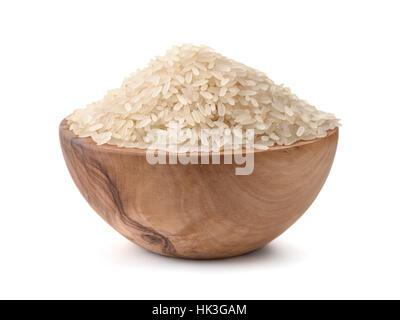 Uncooked dry rice in wooden bowl isolated on white - Stock Photo
