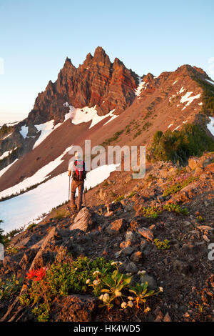 Backpacker Near the Summit of Three Fingered Jack Mountain in Central Oregon - Stock Photo