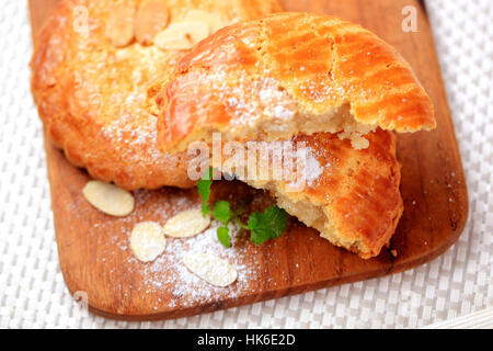 Traditional Dutch treat - Cookie filled with almond paste - Stock Photo
