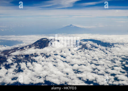 Tanzania, aerial view Mount Kilimanjaro 5895 metre in the back and volcano Mount Meru 4562 metre in the front / - Stock Photo
