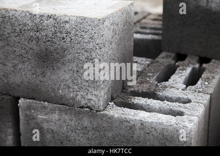 Gray building cinder blocks made of cement stacked close-up. A lot of large concrete bricks stacking texture. Shallow - Stock Photo