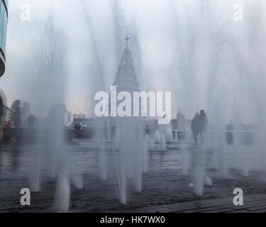 A water fountain and christmas tree near city hall in London. - Stock Photo