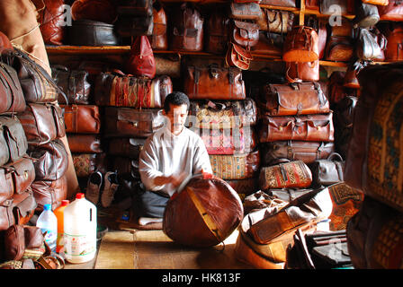 Leather products and craftsman in Fez Morocco - Stock Photo