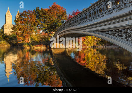 Fall in Central Park at The Lake with the Bow Bridge. Morning view with colorful Autumn foliage on the Upper West - Stock Photo
