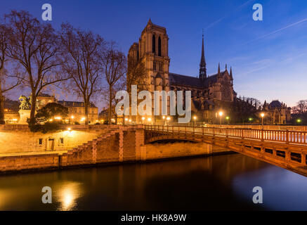 Notre Dame de Paris cathedral at dawn with the Seine River and the Pont au Double. Ile de La Cite. 4th Arrondissement, - Stock Photo