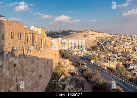 The Old city wall and view of the Mount of Olives in Jerusalem, Israel - Stock Photo