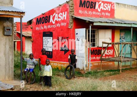 KENYA, County Siaya, village Kotanega, pay by mobile phone, ad Mobicash / KENIA, County Siaya, Dorf Kotanega, bezahlen - Stock Photo