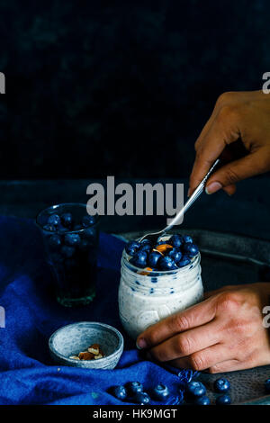 BLUEBERRY CHIA SEEDS OVERNIGHT OATS WITH ALMONDS - Stock Photo