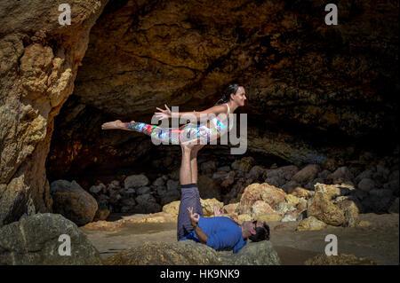 couple doing acro yoga - Stock Photo