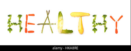 Healthy - word spelled out from vegetables, concept of eating more plant foods; on white