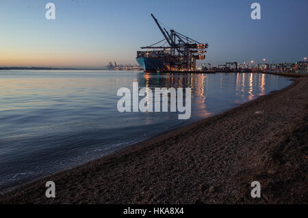 Port of Felixstowe International Trade UK - Ships being loaded and unloaded at dusk at Felixstowe, UK's largest - Stock Photo