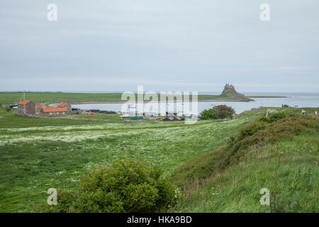 Lindisfarne Castle on Lindisfarne or Holy Island, just off the coast of Northumberland, England - Stock Photo