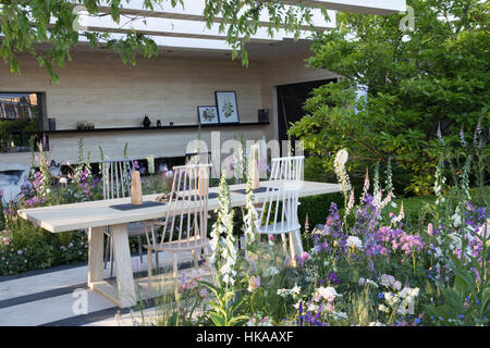 Outdoor dining area, patio, table chairs, RHS Chelsea Flower Show 2016 - Stock Photo