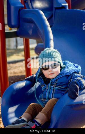 adorable toddler boy playing on park playground - Stock Photo