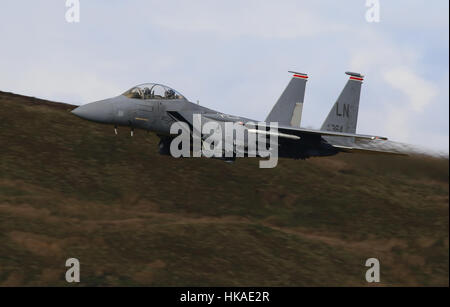 US Air Force F-15E Strike Eagle aircraft, low flying in Wales, UK. - Stock Photo