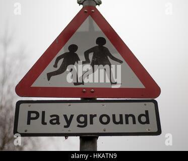 Triangular Playground warning sign  UK urban road sign - Stock Photo