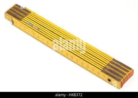 used yardstick isolated on white background - Stock Photo