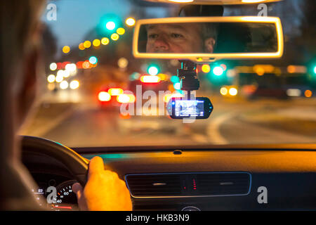 Dashcam in a passenger car, video camera on the windshield, permanently records the traffic in front of the vehicle, - Stock Photo