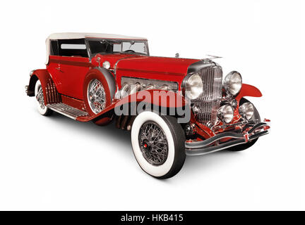 Red 1930 Duesenberg Model SJ Convertible Victoria by Rollston luxury classic vintage car isolated on white background - Stock Photo