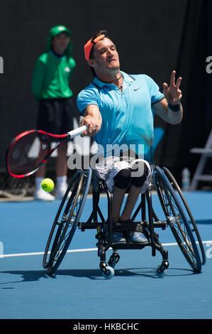 Melbourne, Australia. 28th Jan, 2017. Gustavo Fernandez of Argentina returns the ball during men's wheelchair singles - Stock Photo