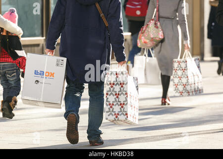 Asian tourists shopping during the Lunar New Year Holiday in the upmarket Ginza shopping area on January 28, 2017, - Stock Photo