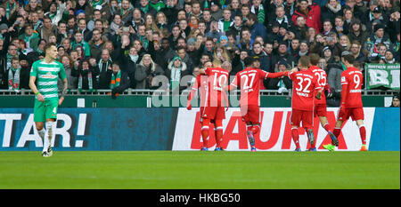Bremen, Germany. 28th Jan, 2017. Munich's players cheer over the 0-1 score while Bremen's Robert Bauer watches on - Stock Photo