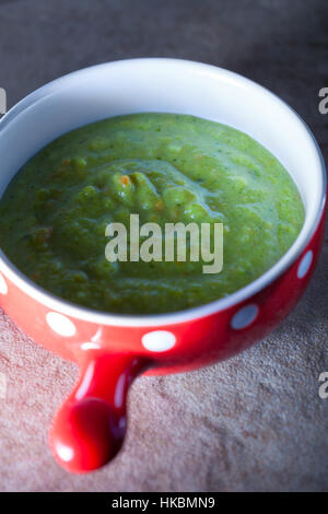 Green creamy vegetable soup with spinach and parsley - Stock Photo