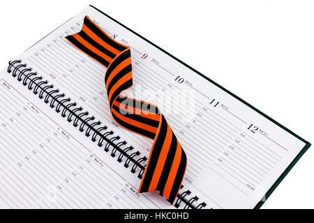 In an open diary sheet is St. George's ribbon twisted spiral - Stock Photo