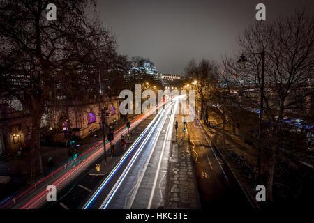 London, UK - January 25, 2016: Light car streaks as seen from the top of Golden Jubilee bridge at embankment station - Stock Photo