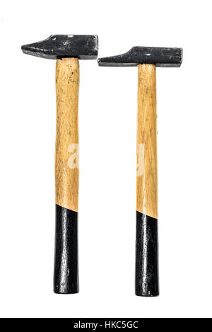 Two old, used hammers isolated on a white background. Black and yellow working tool with wooden handle and metal head.