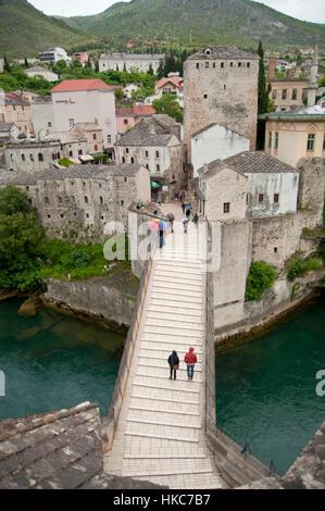 People on the old Bridge of Mostar, Bosnia and Herzegovina - Stock Photo