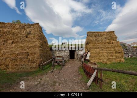Farm scene and stacks of hay in Georgia - Stock Photo