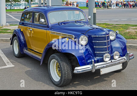 Vintage car soviet made in the parking lot a supermarket - Stock Photo