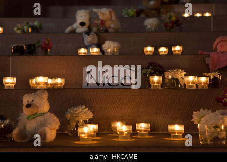 Candles and toys in the Strasbourg Cathedral (Cathedrale Notre-Dame de Strasbourg) in Strasbourg, Alsace, France, - Stock Photo
