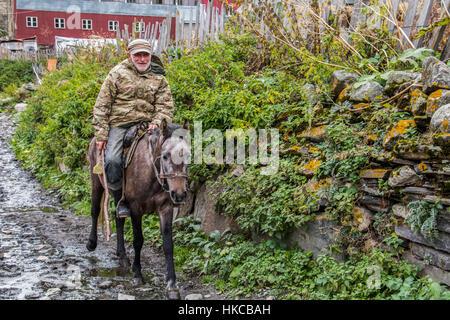 Man on horseback in Zhibiani village; Ushguli, Samegrelo-Zemo Svaneti, Georgia - Stock Photo